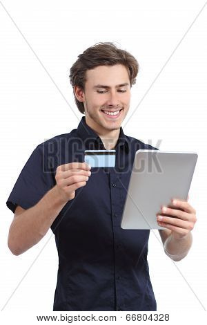 Happy Man Shopping With A Credit Card In A Tablet