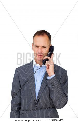 Frustrated Businessman Tangled Up In Phone Wires