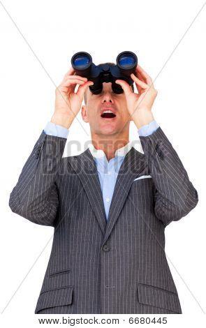 Surprised Businessman Looking Through Binoculars