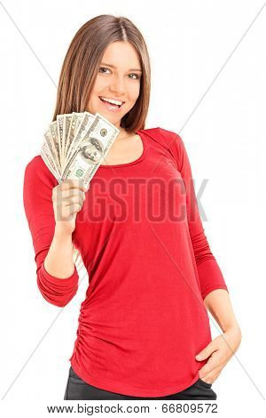 Beautiful young woman holding money isolated on white background