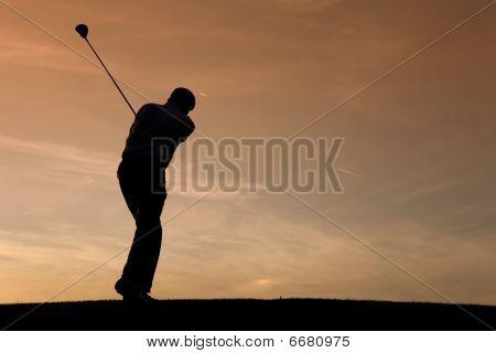 Senior golf player at sunset