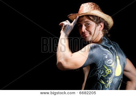 man in hat with bodyart/body-art isolated on black background