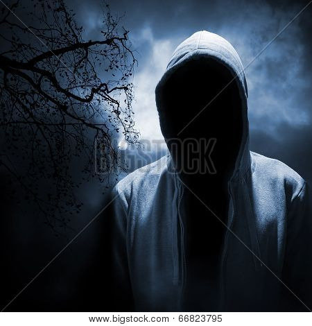 Dangerous Man Hiding Under The Hood In The Dark Night Forest