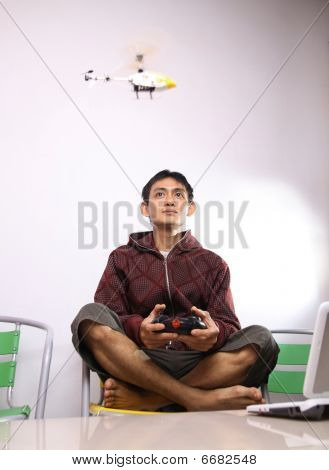 man playing RC helicopter
