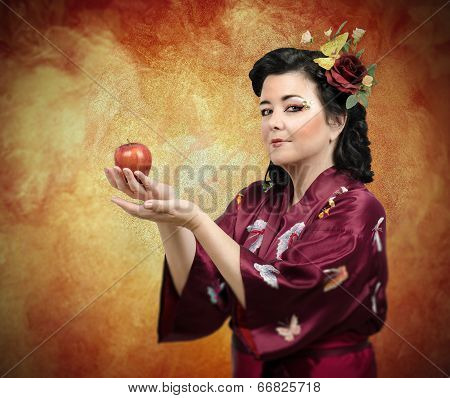 Kimono Woman Extending Her Arms With Apple