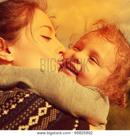 Bright Closeup Portrait Of Happy Mother Kissing Laughing Daughter. Instagram Effect