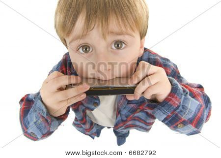 Little boy plays the harmonica