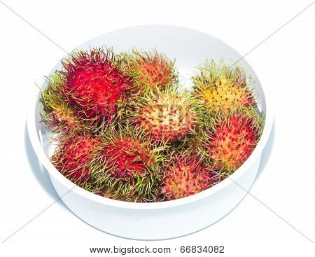 Fresh rambutans tropical fruit on white background.