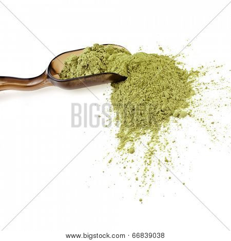 Powdered Green Tea Matcha in spoon , isolated on white background