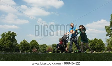 Father and his kids walking in the park