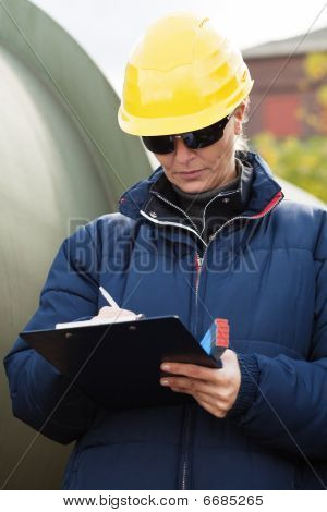 Construciton Engineer Taking Notes