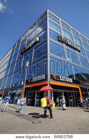 BERLIN, GERMANY - JUNE 11, 2014: Pedestrians walk past a Saturn consumer electronics store in  Berlin, Germany, on Saturday, June 11, 2014. Media-Saturn-Holding GmbH is a German corporate group.