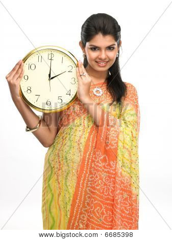 Teenage girl with the clock