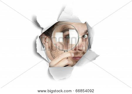 Businessman Looking Through A Paper Hole