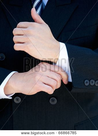 Businessman Hands Adjusting Shirt Cuff