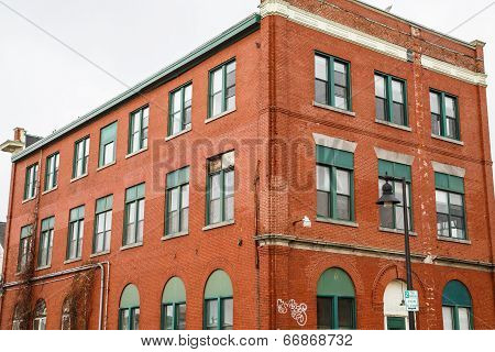 Old Brick Building With Green Windows