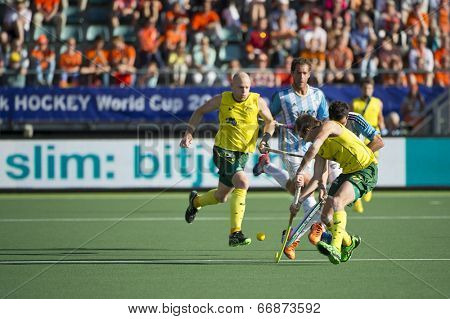 THE HAGUE, NETHERLANDS - JUNE 13: Australia beats Agentina 5 - 1 in the semi-finals of the World Championships Hockey. Cirello and Dwyer (AUS) take control of the ball  in 2014