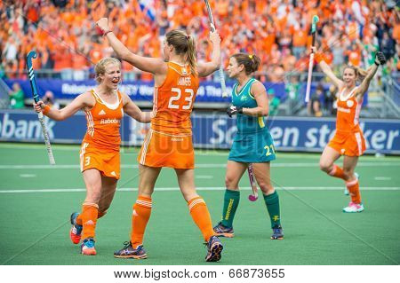 THE HAGUE, NETHERLANDS - JUNE 2: Dutch field hockey player De Waard congratulates Kim Lammers on scoring the 2-0 in the final match against Australia, becoming World Champions