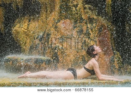 one woman bathing at ma'in hot springs waterfall in Jordan middle east