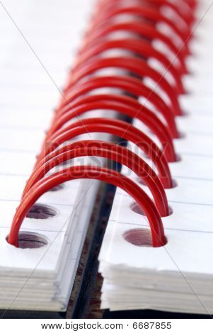 A fragment of the spiral note pad