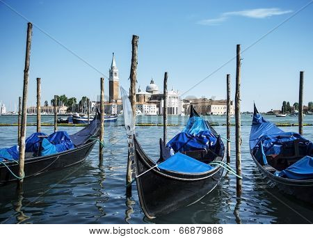 Gondolas on Grand Canal and San Giorgio Maggiore church in Venice, Italy