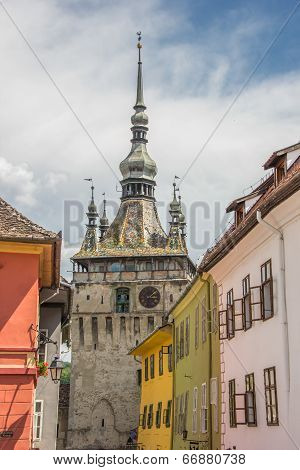 Clock Tower And Colorful Houses In Sighisoara