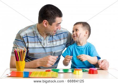 Father And Child Play With Clay Together