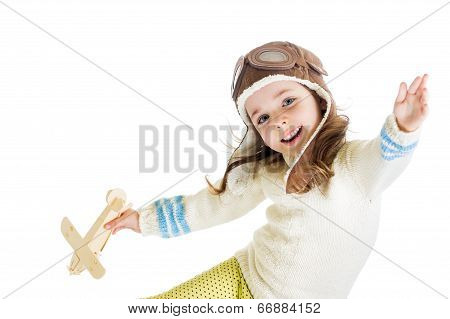 Funny Kid Dressed As Pilot And Playing With Wooden Airplane Toy Isolated On White Background