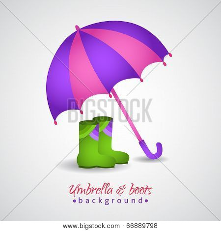 Opened bright umbrella and rain boots