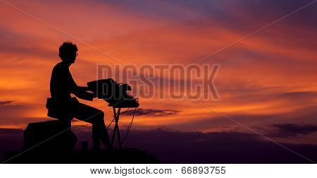 Musician Playing The Electric Piano On The Sunset