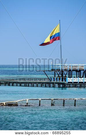 Flag Of Colombia Over The Turqoise Ocean. Cartagena De Indias, South America.