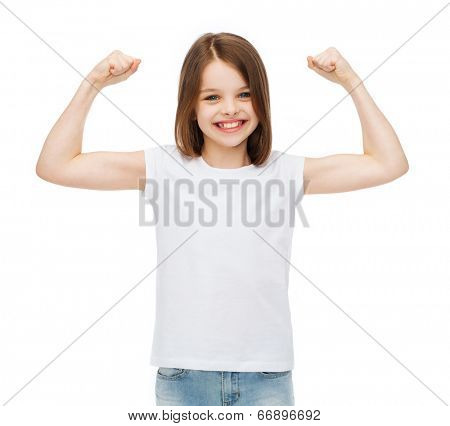 stamina, strength, health, sport, fitness concept - smiling teenage girl in blank white t-shirt showing muscles