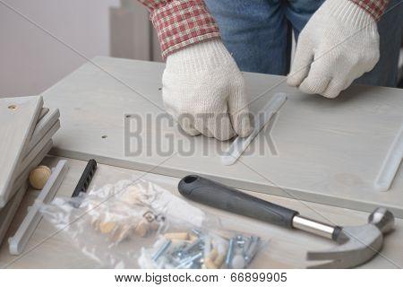 Man assembling the wooden chest