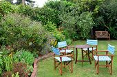 picture of lawn chair  - Garden chairs outdoors in quiet corner on lawn - JPG