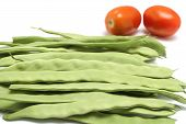 picture of mange-toute  - Snow peas with tomatoes isolated on white - JPG