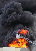 foto of fire brigade  - 	Firefighter and burning house - JPG