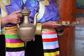 stock photo of tibetan  - Tibetan women serving traditional style milk tea Shangri-La China