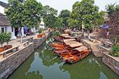 pic of tong  - Photo of a canal in ancient Tongli watertown near Suzhou China with traditional boats and old houses on both sides - JPG