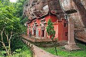 stock photo of taoism  - Temple building leaning against a vertical rock in Qiyun Taoist complex china - JPG