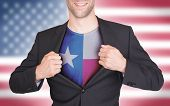 picture of texas state flag  - Businessman opening suit to reveal shirt with state flag  - JPG