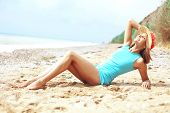 picture of slender legs  - Portrait of beautiful girl with long legs posing on the beach - JPG
