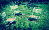 stock photo of lawn chair  - Three Chairs On The Green Lawn On Summer - JPG