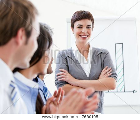 Cheerful Business People Applauding A Good Presentation