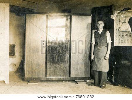 GERMANY, CIRCA 1930: Vintage photo of carpenter in his workshop