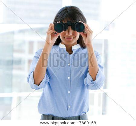 Assertive Female Executive Looking Through Binoculars