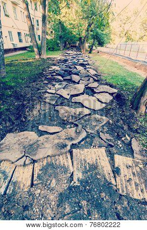 Destroyed Asphalt Pavement