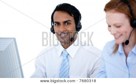 Self-assured Sales Representative Partners With Headsets Against White Background