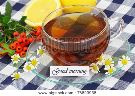 Good morning card with cup of chamomile tea with fresh chamomile flowers