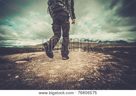 Hiker walking in a valley