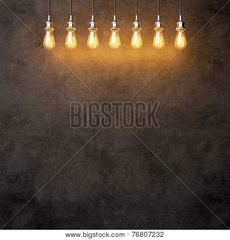 Decorative Vintage Lightbulbs On Dark Concrete Background